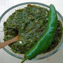 Соус - острая аджика зеленая в кулинарной подаче с перцем